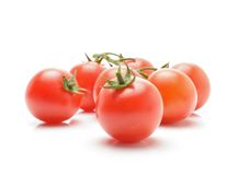 Tomatoes with green stem Royalty Free Stock Image