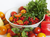 Tomatoes and greens Royalty Free Stock Image