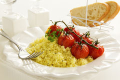Tomatoes grilled with couscous Royalty Free Stock Photo