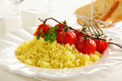 Tomatoes grilled with couscous Stock Image