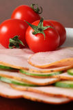 Tomatoes on ham Royalty Free Stock Photos