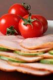 Tomatoes on ham Royalty Free Stock Photos