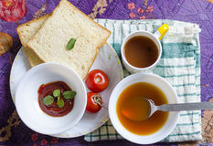 Tomatoes healthy soup with souce and bread slice and black tea Stock Photo