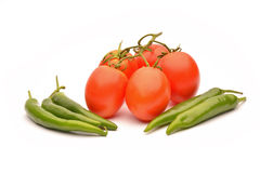 Tomatoes and hot chilli Stock Images