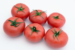 Tomatoes isolated. Group of six tomatoes isolated royalty free stock photography