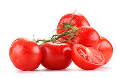 Tomatoes isolated on white. Tomatoes with visible drops of water isolated on white background Stock Image