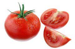Tomatoes isolated on white. Tomatoes with drops isolated on white royalty free stock photo