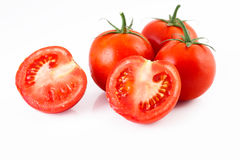 Tomatoes isolated on white background Stock Images