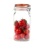 Tomatoes in a jar. On white background royalty free stock photos
