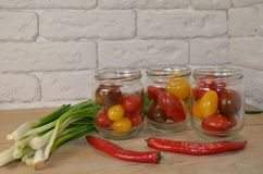 Tomatoes in cans on the table royalty free stock photos
