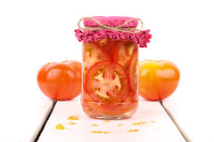 Tomatoes. In a jar with white background Royalty Free Stock Photos