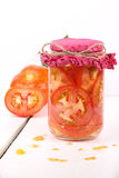Tomatoes. In a jar with white background Royalty Free Stock Photography
