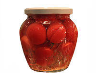 Tomatoes  in jars Stock Photography