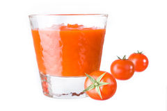 Tomatoes and juice Stock Image