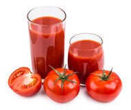 Tomatoes  and juice in glass isolated on white Royalty Free Stock Image