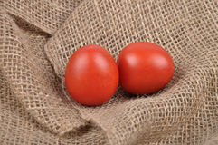 Tomatoes on jute Stock Images