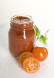 Tomatoes and ketchup. Cherry red tomatoes and ketchup Royalty Free Stock Photography