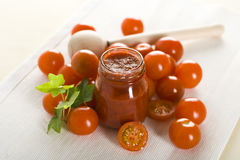 Tomatoes and ketchup. Cherry red tomatoes and ketchup Royalty Free Stock Photo