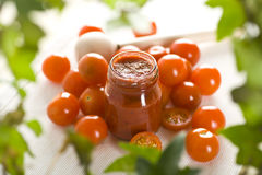 Tomatoes and ketchup. Cherry red tomatoes and ketchup Stock Photography