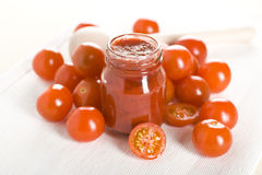 Tomatoes and ketchup Stock Images