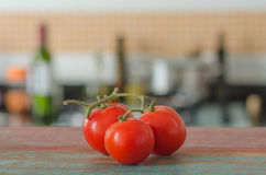 Tomatoes and kitchen. Ingredients in wood table Royalty Free Stock Images