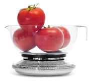 Tomatoes on a kitchen scale Stock Photo