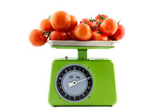 Tomatoes on a kitchen scale Stock Photography