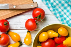 Tomatoes on kitchen table Stock Photos
