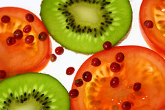 Tomatoes and kiwi Royalty Free Stock Photo