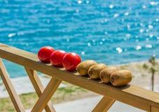 Tomatoes and kiwifruit Stock Photos