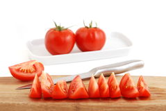 Tomatoes and knife Royalty Free Stock Photos