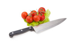 Tomatoes and knife stained with ketchup over white Stock Photos