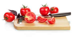 Tomatoes and knife Stock Image