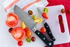 Tomatoes and knives Royalty Free Stock Photography