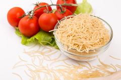 Tomatoes, leaf and paste isolated on a white Stock Photos