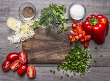 Tomatoes, leek parsley and dill chopped red pepper green onion on a wooden cutting board  wooden background top view Royalty Free Stock Photography