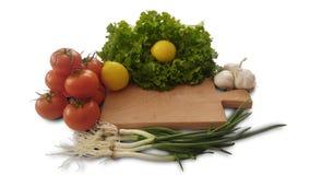 tomatoes, lemon, lettuce, garlic and fresh salad onion stock photo