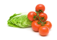 Tomatoes and lettuce on white background Stock Photos