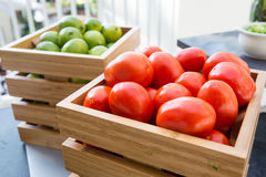 Tomatoes and limes Stock Images
