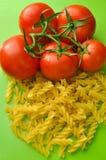 Tomatoes macaroni Stock Images