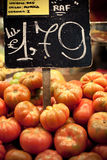 Tomatoes at the market. Price sign between tomatoes at the market Royalty Free Stock Photo