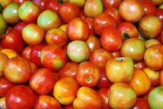 Tomatoes on the market. Fresh tomatoes on street market for sale Stock Photos
