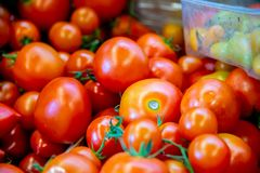 The tomatoes at the market display stall. Tomatoes at the market display stall royalty free stock photo