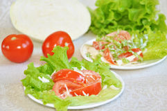 Tomatoes with mayonnaise on lettuce Stock Images