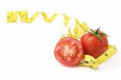 Tomatoes with measuring tape Stock Photography