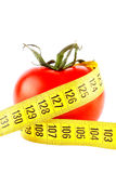 Tomatoes with measuring tape Royalty Free Stock Images