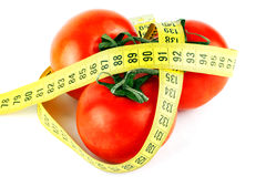 Tomatoes with measuring tape Royalty Free Stock Photography