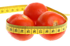 Tomatoes with measuring tape as losing weight Royalty Free Stock Photography