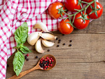 Tomatoes, mint, garlic and pepper on dark wood and dish towel Royalty Free Stock Photography