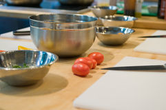 Tomatoes and mixing bowls Royalty Free Stock Photos
